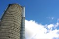 Towering silo and blue sky a large tall farm is over viewer with a cloudy background Stock Photos