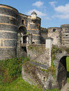Towers and drawbridge of the angevine castle angers france view from east entrance Stock Images
