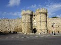 Towers guards the entrance outside the city walls, Rhodes, Greece Royalty Free Stock Photo