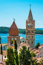 Towers on the rab cathedral and church of st justina in old center city an island in croatia Stock Image