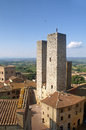 Towers of san gimignano and houses a historic city in tuscany italy Royalty Free Stock Photo