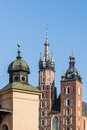 Towers of st mary church and the fragment sukienice cloth market in the main square in krakow poland Royalty Free Stock Photography