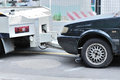 Photo : Towing a dumped car semi hook
