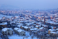 Town covered by snow at evening. Alba, Italy. Royalty Free Stock Photography