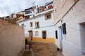 Town with dwellings houses caves built into rock alcala del j jucar province of albacete spain Royalty Free Stock Images