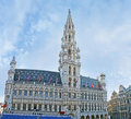The town hall brussels belgium june on grand place decorated with old religious flags before ommegang celebration on june Stock Photos