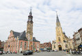 Town hall and the church of our lady in sint truiden limburg b belgium april unidentified people cars at central market square Royalty Free Stock Images