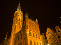 Town hall in gdansk by night historic old of the historic beautiful and big tower with clock Stock Photo