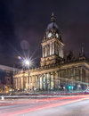 Town hall in leeds west yorkshire uk night shot of with light trail also a local landmark of Royalty Free Stock Images