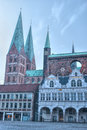 Town hall and st mary s church lübeck the towers of in the second largest city in schleswig holstein in northern germany one Stock Image