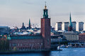 Town hall stockholm sweden the with its tower and the historical buildings of downtown at the shore of ridarfjarden Stock Photography