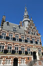 Town hall a world heritage site in city franeker netherlands the frontage with tower of the medieval the facade is the coat of Royalty Free Stock Image