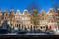 Town houses amsterdam row of in the netherlands on a sunny winter day Royalty Free Stock Image