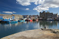 Town of kirkwall seen from harbour boats docked in orkney s capital Stock Photos