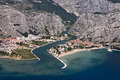 Town omis croatia aerial view city in between adriatic sea mountain omiska dinara and river cetina Stock Photos