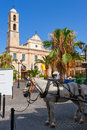 Town square chania crete greece greek orthodox cathedral church of the trimartyri horse in the foreground Stock Photo