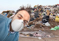 Toxic and polluted air young boy with mask respiratory protection near landfill Royalty Free Stock Photos