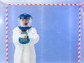 Toxic waste alert female scientist wearing white protection suit and blue mask holding a container Stock Photo