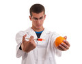 Toxin injection in orange with syringe genetically modified food gmo Stock Images