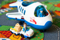 Toy airlines set of children s toys out of the plane and the truck in the nursery Royalty Free Stock Photography