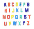 Toy alphabet letters detailed plastic on a pure white background shadows have been modified so they will remain even when Stock Images