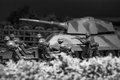 Toy army attacking close up picture of soldiers and a tank resembling an scene Stock Image