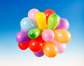 Toy balloons on a blue sky background Royalty Free Stock Image