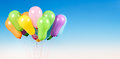 Toy balloons on a blue sky background Stock Image