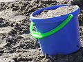 Toy Beach Bucket full of Sand Royalty Free Stock Photo