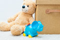 Toy bear and clockwork elephant with brown textile box with hand Royalty Free Stock Photo