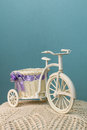 Toy bike on a blue background crocheted cushion against Stock Photography
