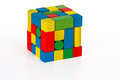 Toy blocks jigsaw cube multicolor puzzle pieces over white background Stock Photo