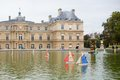 Toy boats in the luxembourg garden of paris france Stock Image