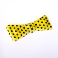 Toy bow tie plastic yellow with black polka dots Royalty Free Stock Image