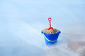 Toy bucket at beach Stock Images