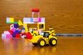 Toy bulldozer with bricks