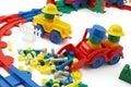 Toy bulldozer and railway on white background Royalty Free Stock Photo