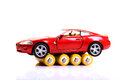 Toy car and batteries Royalty Free Stock Images