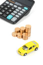 Toy car and calculator with coin Stock Photo