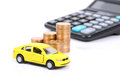 Toy car and calculator with coin Stock Images