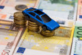 Toy car on coin and euro bills Royalty Free Stock Photo