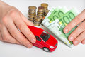 Toy car and euro money - insurance, rent and buying car Royalty Free Stock Photo