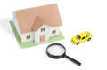 Toy car and house with magnifier Royalty Free Stock Photography