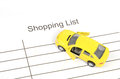Toy car and shopping list Stock Photo