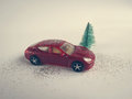 Toy car with a small Christmas tree Royalty Free Stock Photo