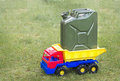 Toy car the truck with green canister Royalty Free Stock Photo