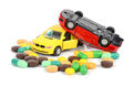 Toy cars and medicine Stock Photo