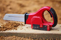 Toy chain saw in the sandbox Royalty Free Stock Image