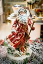 Toy christmas decor and decorations for home. merry santa dancing and spinning in the dance. macro photo. Royalty Free Stock Photo