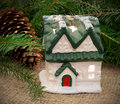 Toy christmas house with fir branches behind Royalty Free Stock Photos